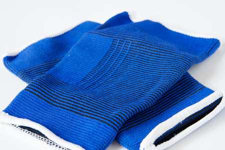 elbow brace: Pair of blue sport supporters put on a white background.