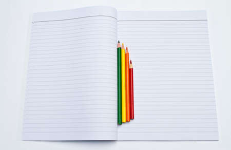 Opening book and Crayon on white background. photo