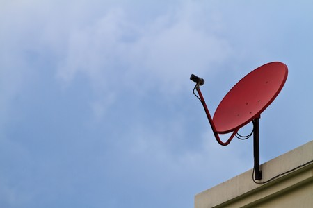 Satellite dish with blue sky photo
