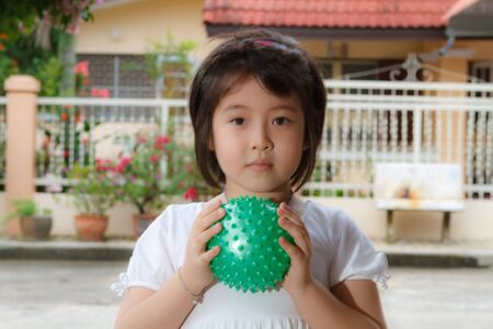 little girl playing with ball photo