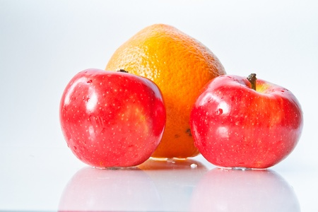 antipode: Food Related: Apples and Orange Isolated on a White Background