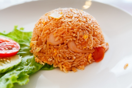 Fried Rice with Sausage on white dish. photo
