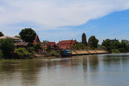 Thai temple at Ayutthaya in Thailand and most famous for tourist take photo from the river. photo