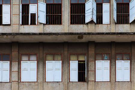 Old windows on ruin house photo
