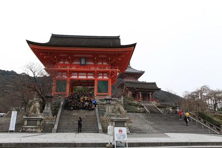 KYOTO-MAR 7: People take photo at the Niomon gate in Kiyomizu-dera temple  on March 7, 2012 in Kyoto, Japan. Here, built in 1633, is one of the most famous landmark of Kyoto with UNESCO World Heritage.