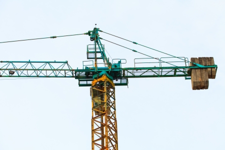 Construction site with  crane on white isolated photo