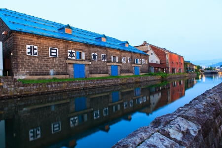 OTARU, JAPAN - August 15: Warehouses along the famed canal August 15, 2013 in Otaru, Japan. The historic structures date from early colonialization of Hokkaido in the early 1800s.