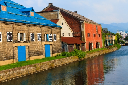 OTARU, JAPAN - August 15: Warehouses along the famed canal August 15, 2013 in Otaru, Japan. The historic structures date from early colonialization of Hokkaido in the early 1800s. photo