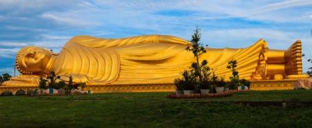 reclining: Reclining Buddha with blue sky.