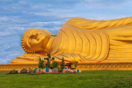 reclining: Reclining Buddha with blue sky  Stock Photo