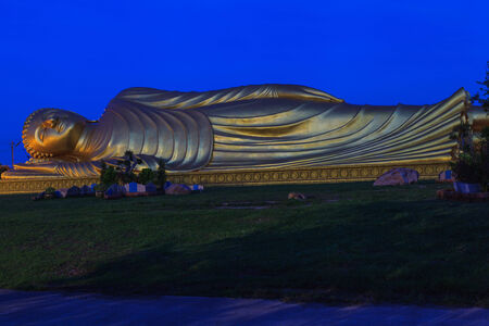 Reclining Buddha with blue sky. photo