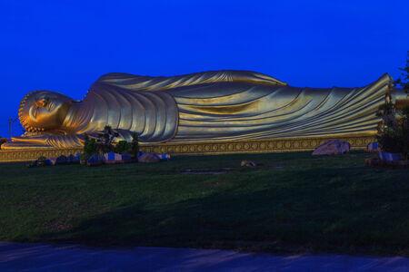 Reclining Buddha with blue sky. photo