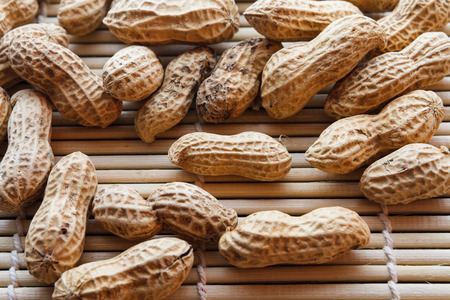 groundnut: Nut peanut groundnut on wood. Stock Photo