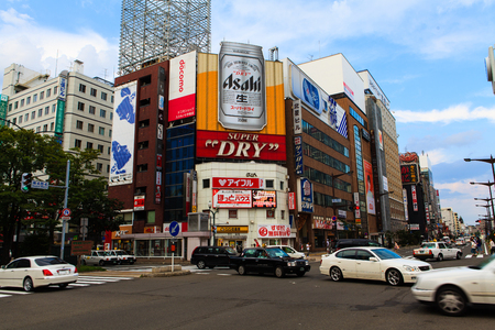 SAPPORO, JAPAN - August 13, 2013: Traffic passes through the Susukino District. Susukino is one of the three major red-light districts within Japan.