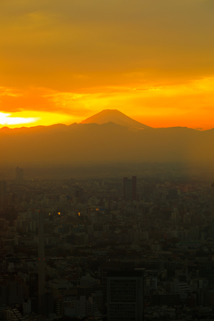 Mountain Fuji with sunset and the town in foregrund