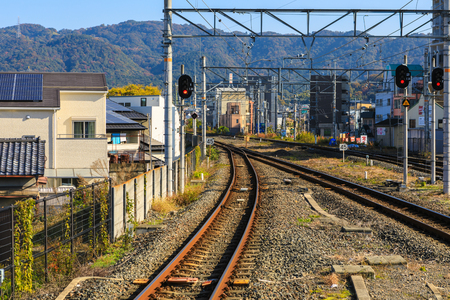 Train track at Uji Station with Mountain Backgroud.
