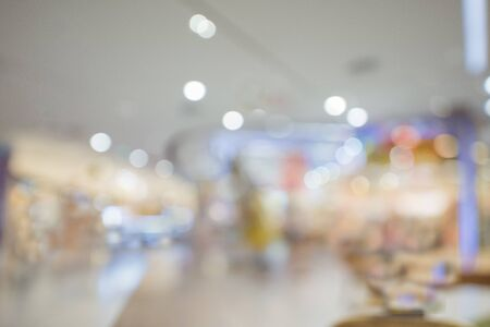 Abstract bokeh and blur beautiful luxury shopping mall and retails store interior for background. Business background.