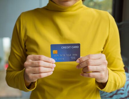 Female hand holding a credit card. Online shopping concept.