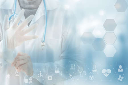 Close-up doctor wearing gloves isolated on Health care icon pattern medical innovation concept background design. Zdjęcie Seryjne