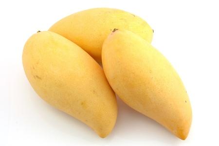 mango isolated: Three mangoes  Stock Photo