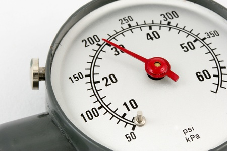 closeup of tire pressure gauge meter photo