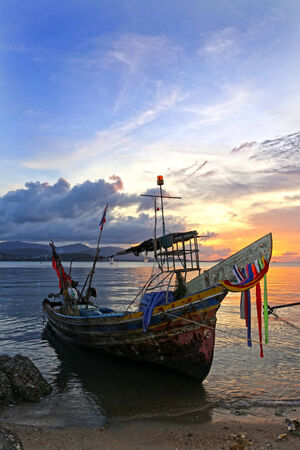 fishing boat in the evening time photo