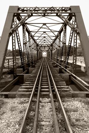 Railroad bridge in thailand ,Sepia color effect vintage style