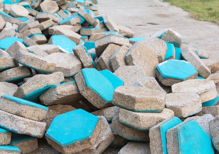 a pile of blue concrete paver Stock Photo