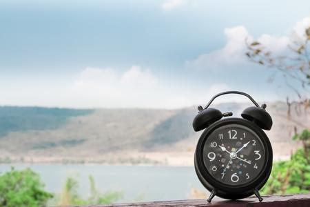 Retro Alarm Clock in the nature background. Alone