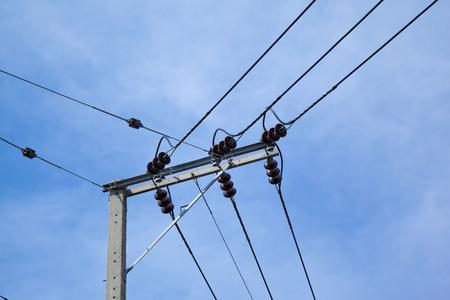 electricity pole: High voltage electricity pole with blue sky background. Stock Photo