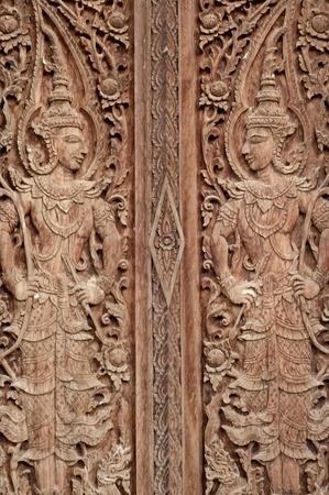 wood molding: Thai molding art on the wall made of wood, Kanchanaburi province, Thailand.