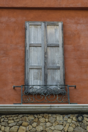 Old wooden window on the orange wall  photo