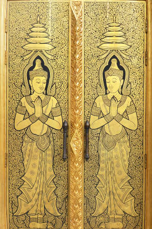 gold angel door of wattraimitr temple photo