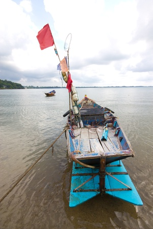 Small fishing boats on the beach in Phetchaburi  photo