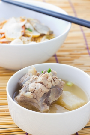cooked instant noodle: Pork rib soup traditional chinese cuisine clear broth  Stock Photo
