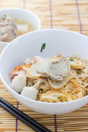 asian noodle: Noodles and meatball with chopsticks , asian noodle