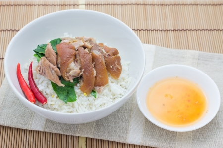 Braised Pork with Mei Gan Cai on plain rice photo