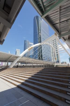 Pubic skywalk with modern buildings of Bangkok