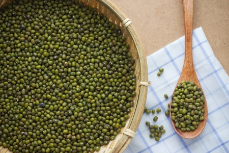 green mung beans over the wooden spoon photo