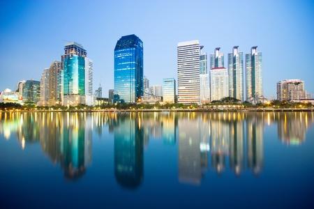 Bangkok city downtown at night with reflection of skyline, Bangkok,Thailand