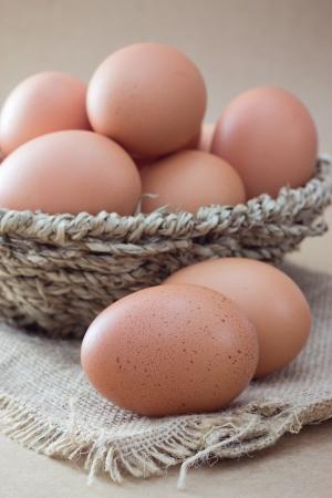 Basket with eggs on sackcloth Stock Photo