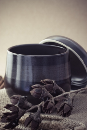 sparce: Black cup of tea with steam on brown background Stock Photo