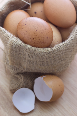 Brown eggs in canvas sack photo