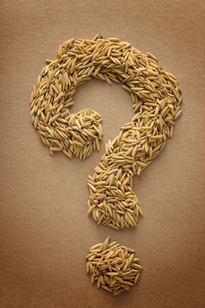 muddle: Paddy in question mark shape on brown background Stock Photo