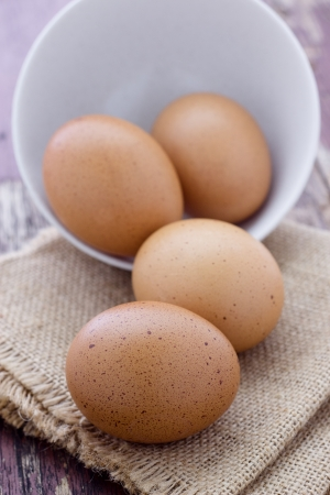 maturation: Eggs in white bowl on a table Stock Photo