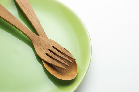 Empty plate, wooden spatula and spoon, concept, top view photo