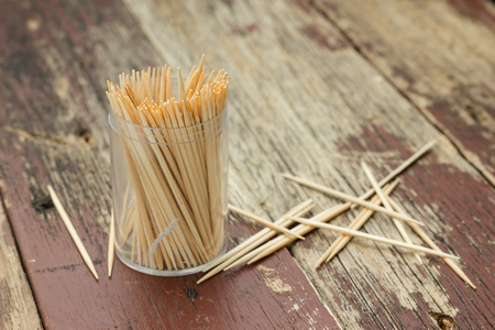 Wooden Toothpicks on wood background photo