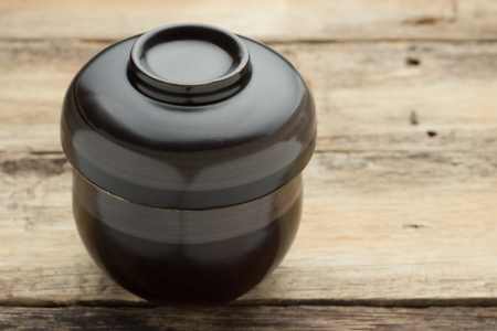 sparce: Black cup of tea with steam on wooden table
