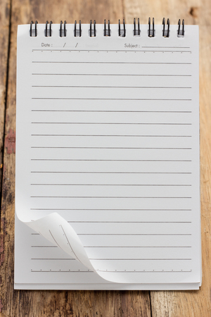 teared paper: Paper page notebook  textured isolated on the wood backgrounds Stock Photo