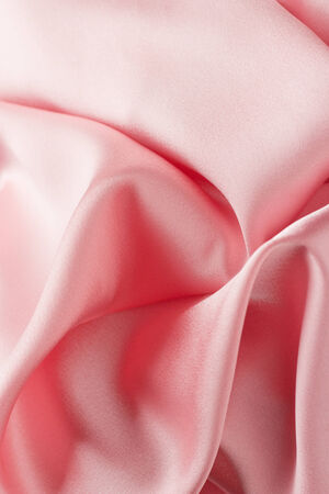 pink satin: Chaotic drapery of delicate pink satin